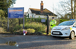 © Licensed to London News Pictures. 19th December 2014. Essex, UK. A police officer at the entrance to Chelmsford Museum, Oaklands Park in Chelmsford, the scene of the murder of an 18 year old male who was fatally stabbed yesterday . Two males aged 17 and 19 have been arrested in relation to this matter and remain in custody. Photo credit : Simon Ford/LNP