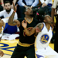 12 June 2017: Cleveland Cavaliers guard JR Smith (5) vies for the rebound with Golden State Warriors forward Andre Iguodala (9) during the Golden State Warriors 129-120 victory over the Cleveland Cavaliers, in game 5 of the 2017 NBA Finals, at the Oracle Arena, Oakland, California, USA.