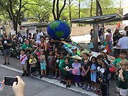 "Students from Arabic Immersion Magnet School with ""The AIMS Flying Globe."""
