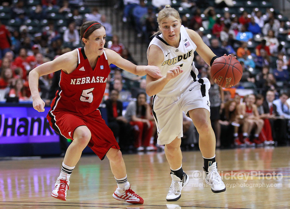 March 04, 2012; Indianapolis, IN, USA; Purdue Boilermakers guard Brittany Rayburn (5) dribbles the ball against Nebraska Cornhuskers guard Kaitlyn Burke (5) during the finals of the 2012 Big Ten Tournament at Bankers Life Fieldhouse. Purdue defeated Nebraska 74-70 in 2OT. Mandatory credit: Michael Hickey-US PRESSWIRE