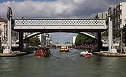 Pont Levant de la Rue de Crimee, over the Canal de l'Ourcq, in the 19th arrondissement of Paris, France. The pont levant is a steel road bridge, the first lift bridge built in France, designed by Felix Eugene Edmond Humblot and built by L Le Chatelier in 1885. Behind it is the Passerelle de la Rue de Crimee, a pedestrian footbridge. The Canal de l'Ourcq is a 108.1km waterway begun in 1802 between Port-aux-Perches and the Canal Saint-Martin via the Bassin de la Villette or La Villette Basin. Picture by Manuel Cohen
