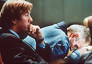 Dr. Jack Kevorkian, assisted suicide activist, rests his head on the defense table during a hearing with his attorney Geoffrey Fieger, left. Kevorkian was weak from a hunger strike to protest his arrest for assisting in a suicide. He was later released after promising that he would not participate in the suicide deaths of any other individuals.