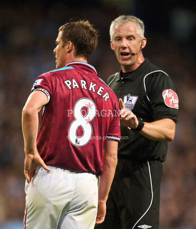 MANCHESTER, ENGLAND - Sunday, September 27, 2009: West Ham United's Scott Parker is spoken to by referee Chris Foy during the Premiership match at the City of Manchester Stadium. (Pic by Chris Brunskill/Propaganda)