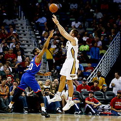 Nov 16, 2013; New Orleans, LA, USA; New Orleans Pelicans power forward Ryan Anderson (33) shoots over Philadelphia 76ers power forward Brandon Davies (20) during the first half of a game at New Orleans Arena. Mandatory Credit: Derick E. Hingle-USA TODAY Sports