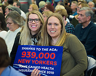 Westbury, New York, USA. January 15, 2017.  SUE MOLLER, LAURIE GRAB, sisters, Our First Stand; rally; rallies; healthcare; health; care; ACA; Affordable Care Act; sisters; sister; sibling; siblings; young; woman; women; hold; poster; posters; holding; sign; signs; audience; crowd; Obamacare; repeal; against; repealing; anti-Trump; Westbury; Nassau County; Long Island; New York; United States; America; peaceful; protest; protests; protester; protesters; protesting