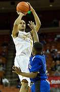 Jeremiah Jefferson (15) of Dallas Triple A Academy shoots the ball against Mumford during the UIL 1A division 1 state championship game at the Frank Erwin Center in Austin on Friday, March 8, 2013. (Cooper Neill/The Dallas Morning News)