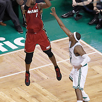 07 June 2012: Miami Heat power forward Chris Bosh (1) takes a jumpshot over Boston Celtics small forward Paul Pierce (34) during first half of Game 6 of the Eastern Conference Finals playoff series, Heat at Celtics at the TD Banknorth Garden, Boston, Massachusetts, USA.