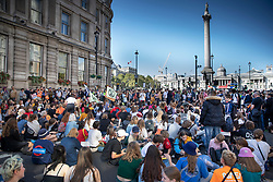 © Licensed to London News Pictures. 20/09/2019. London, UK. Activists taking part in the Global Climate Strike demonstration hold a sit down protest near Trafalgar Square. Thousands of similar actions are taking place all over the UK and the rest of the world. Photo credit: Peter Macdiarmid/LNP