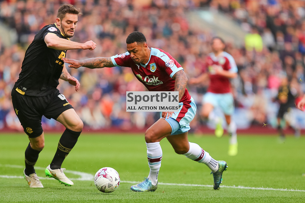 Andre Gray wins the ball with  Dorian Dervite in pursuit during Burnley v Bolton, Sky Bet Championship, 17 October 2015,  (c) Jackie Meredith/SportPix.org.uk