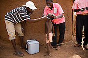 Health workers vaccinate a child during a national polio immunization exercise in the village of Wantugu, northern Ghana on Friday March 27, 2009.