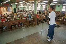 Young singer entertaining workers at the Partagas cigar factory; Havana; Cuba,