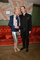 ALI MAPLETOFT and artist MARC McGREEVY at a reception to launch an exclusive auction of hand-painted silk scarves by some of the UK's hottest designers in aid of Save The Children by Mary's Living & Giving shops, held at the May Fair Hotel, Stratton Street, London on 12th February 2014,
