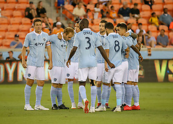 August 4, 2018 - Houston, TX, U.S. - HOUSTON, TX - AUGUST 04:  Sporting KC starting players join in a huddle during the soccer match between Sporting Kansas City and Houston Dynamo on August 4, 2018 at BBVA Compass Stadium in Houston, Texas.  (Photo by Leslie Plaza Johnson/Icon Sportswire) (Credit Image: © Leslie Plaza Johnson/Icon SMI via ZUMA Press)