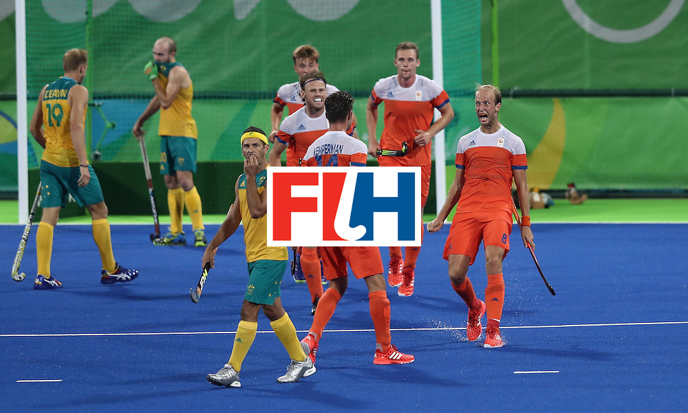 RIO DE JANEIRO, BRAZIL - AUGUST 14:  Billy Bakker (R) of the Netherlands celebrates after scoring his second goal during the Men's hockey quarter final match between the Netherlands and Australia on Day 9 of the Rio 2016 Olympic Games at the Olympic Hockey Centre on August 14, 2016 in Rio de Janeiro, Brazil.  (Photo by David Rogers/Getty Images)