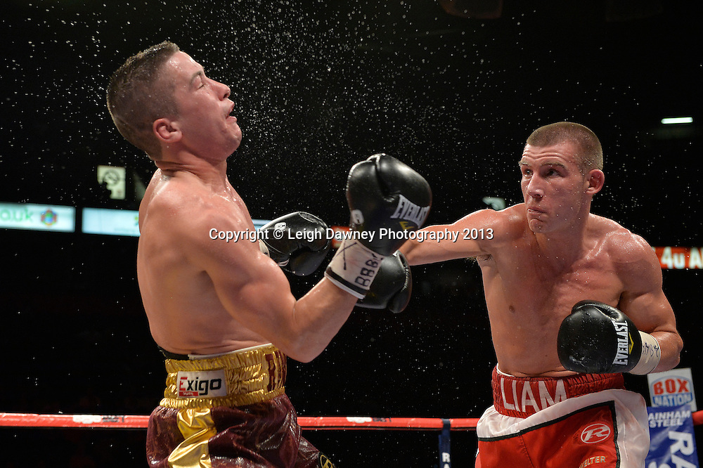 Liam Williams defeats Ronnie Heffron after Heffron's corner retired him. British Light Middleweight Title eliminator on 26th July 2014 at the Phones 4U Arena, Manchester. Promoted by Frank Warren. © Credit: Leigh Dawney Photography.