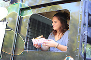 Food truck server holds order of fries in Jefferson Barracks Park during one of the many Food Truck Fest events sponsored by St. Louis County Parks throughout summer; St. Louis, MO