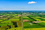 Nederland, Gelderland, Achterhoek, 29-05-2019; landelijk gebied tussen Ruurlo en Groenlo met onder andere de provinciale weg N319 en de spporlijn WInterswijk - Zutphen. In het kader van zogenaamde verkeersveiligheid dreigen veel bomen (zomereiken) langs de weg gekapt te worden.<br /> Provincial road between Ruurlo and Groenlo. Because of so-called road safety, many trees (summer oaks) are to be felled along the road.<br /> <br /> luchtfoto (toeslag op standard tarieven);<br /> aerial photo (additional fee required);<br /> copyright foto/photo Siebe Swart