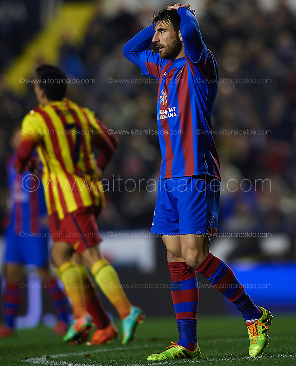 VALENCIA, SPAIN - JANUARY 2: Nikolaos Karampelas of Levante UD  reacts during the SM Copa del Rey between Levante UD and FC Barcelona de at the Ciutat de Valencia stadium January 22, 2014 in Valencia, Spain. (Photo by Aitor Alcalde).