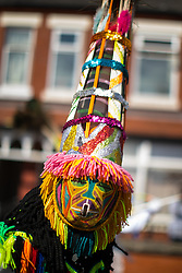 © Licensed to London News Pictures . 12/08/2017 . Manchester , UK . The annual Caribbean Carnival J'Ouvert Parade through Moss Side in South Manchester . The 2017 theme is Bacchanal . There is concern in the community following the stabbing to death of Sait Mboob during a mass fight which saw several seriously hurt on Tuesday night (8th August 2017) . Photo credit : Joel Goodman/LNP