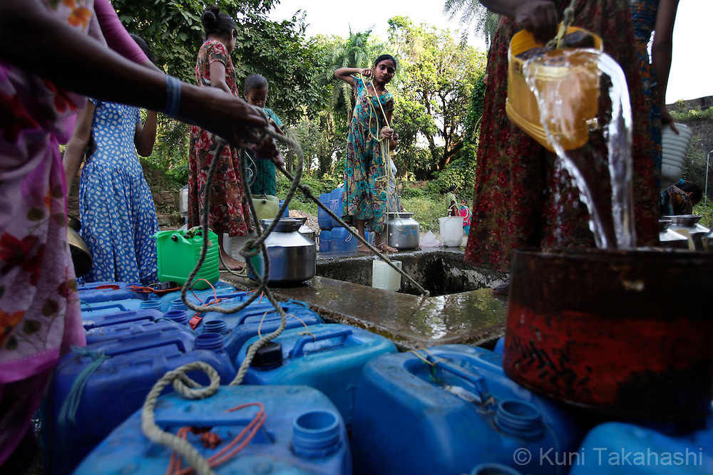 Women collect the water from the well in Women collect the water from the well in Vasai, northern outskirts of Mumbai, India on Oct. 26, 2009. The wells are only source of the water in this fishing village. Due to a lack of rainfall in the monsoon season, the city government imposed massive water cuts as Mumbai faced one of the worst water shortages in its history. (Photo by Kuni Takahash