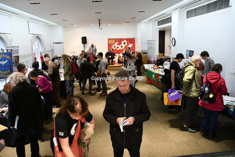 No More War - Remembrance Sunday 2018 ceremony for the victims by invaders of Vietnam war and Korea war and throughout South America, Africa,Asia and the middle east and to remembrance and peace, 100 years after ,end of the First World War continues film screening, stalls and workshop in Friends House Euston on 11 November 2018, London, UK,