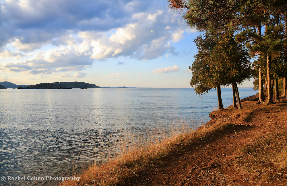 The sun sure does shine brightly with the warm glow of golden hour on Presque Isle Park in Marquette Michigan!