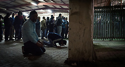 8 October 2018, Jerusalem, Occupied Palestinian Territories: It's 5.18 in the morning, and in the open space by the checkpoint, a group of men step aside for a moment for Fajr prayer ('dawn prayer') before going through the turnstiles. Qalandiya is the main checkpoint between the northern West Bank and Jerusalem, where thousands upon thousands of Palestinians try to make their way to Jerusalem each day. Ecumenical accompaniers (EAs) from the World Council of Churches' Ecumenical Accompaniment Programme in Palestine and Israel (WCC-EAPPI) visit regularly in the early mornings. Their task is to be an international presence and to show solidarity, offer basic support to anyone denied passage, and collect documentation of the situation at the checkpoint. EAs' reports feed into the UN system, providing ongoing monitoring of the human rights situation in Israel and Palestine.