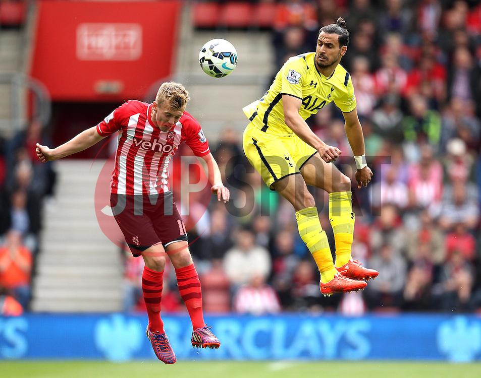 Southampton's James Ward-Prowse beats Tottenham Hotspur's Nacer Chadli to a header - Photo mandatory by-line: Robbie Stephenson/JMP - Mobile: 07966 386802 - 25/04/2015 - SPORT - Football - Southampton - ST Marys Stadium - Southampton v Tottenham Hotspur - Barclays Premier League