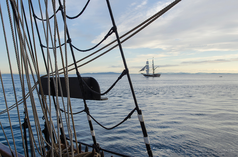 Lady Washington seen through rigging of Hawaiian Chieftain. Semiahmoo Bay, Washington. A historic replica of the original 18th Century brig. Owned and operated by the Grays Harbor Historical Seaport, Aberdeen, Washington