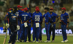 September 17, 2018 - Abu Dhabi, United Arab Emirates - Afghanistan cricketer Rashid Khan celebrates with his team mates  after taking a wicket during the 3rd cricket match of Asia Cup 2018 between Sri Lanka and Afghanistan at the Sheikh Zayed Stadium,Abu Dhabi, United Arab Emirates. 09-17-2018  (Credit Image: © Tharaka Basnayaka/NurPhoto/ZUMA Press)