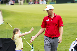 May 5, 2019 - Charlotte, North Carolina, United States of America - Brendon Todd gives a five to a fan after the fifth hole during the final round of the 2019 Wells Fargo Championship at Quail Hollow Club on May 05, 2019 in Charlotte, North Carolina. (Credit Image: © Spencer Lee/ZUMA Wire)