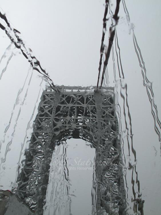 Driving on the Brooklyn Bridge during a rain storm.