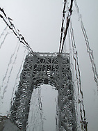 Driving on the Brooklyn Bridge during a rain storm.