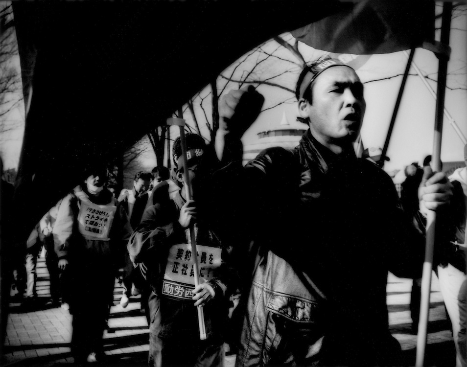 Japanese workers, seeking a proletarian revolution, mark from demonstration in Tokyo's Yoyogi Park, Tokyo, Japan.  Japanese are famously stoic but cracks are forming in the poker-faced nation's facade.