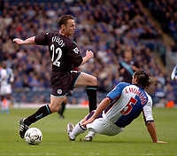 Photo. Glyn Thomas, Digitalsport.<br /> Blackburn Rovers v Leicester City. <br /> FA Barclaycard Premiership. 17/04/2004.<br /> Leicester's Paul Dickov (L) skips away fromm Lorenzo Amoruso's challenge.