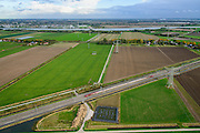 Nederland, Zuid-Holland, Gemeente Strijen, 23-10-2013l; hogesnelheidstrein Thalys op HSL-spoor doorkruist de Hoeksche Waard, onderweg naar Rotterdam CS. Water van de Dortsche Kil aan de horizon.<br /> Thalys high-speed train on HSL track crosses the Hoekschewaard, en route to Rotterdam Centra Station. Water Dortsche Kil on the horizon.<br /> luchtfoto (toeslag op standard tarieven);<br /> aerial photo (additional fee required);<br /> copyright foto/photo Siebe Swart