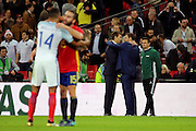 England caretaker manager Gareth Southgate talking to Spain manager Julen Lopetgui after final whistle during the Friendly match between England and Spain at Wembley Stadium, London, England on 15 November 2016. Photo by Matthew Redman.