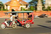 29 JUNE 2013 - PHNOM PENH, CAMBODIA:  A tuk-tuk three wheeled taxi in Phnom Penh, Cambodia. Tuk-tuks are used as taxis throughout Asia.     PHOTO BY JACK KURTZ