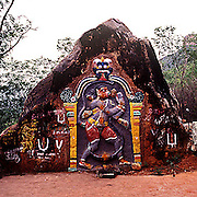 The sacred and  colourful form of the 'monkey God' Hanuman,worshipped by Hindus ,carved on a rock on the trekking route to the most popular of Hindu temples,the hill shrine of.Lord Venkateswara also affectionately called Balaji, located in the Saptagiri(seven hills) mountain range ,eastern ghats,Andhra Pradesh,India.