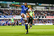 AFC Wimbledon defender Rod McDonald (4) tussles with Ipswich Town defender Janoi Donacien (2) during the EFL Sky Bet League 1 match between Ipswich Town and AFC Wimbledon at Portman Road, Ipswich, England on 20 August 2019.