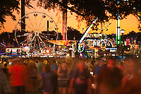 St. Paul, MN, USA - Aug 26, 2011. Minnesota State Fair at dusk with large Friday night crowd in motion.