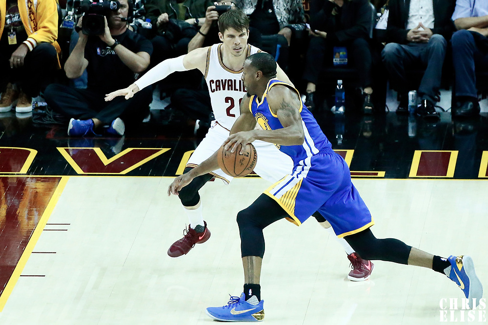 07 June 2017: Golden State Warriors forward Andre Iguodala (9) drives past Cleveland Cavaliers guard Kyle Korver (26) during the Golden State Warriors 118-113 victory over the Cleveland Cavaliers, in game 3 of the 2017 NBA Finals, at  the Quicken Loans Arena, Cleveland, Ohio, USA.