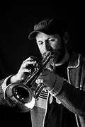 Matthew Halsall, Photographed in a studio in London. Manchester based, DJ, bandleader and trumpeter Matthew Halsall is one of the UK&rsquo;s brightest talents. A gifted trumpeter with a beautiful, expressive tone, his music draws on his love of the transcendental, spiritual and modal jazz of Alice and John Coltrane and Pharoah Sanders, as well as the glories of &lsquo;60s British jazz. His previous albums &lsquo;Sending My Love&rsquo; and &lsquo;Colour Yes&rsquo; released on his own Gondwana label have won him a legion of fans across the world and acclaim from the likes of Gilles Peterson, Jamie Cullum and Radio 3&rsquo;s Late Junction, MOJO, BBC Music Magazine and even BBC 6 Music.<br /> His third album &lsquo;On The Go&rsquo; is a heartfelt love letter to the jazz of the late &lsquo;50s and early &lsquo;60s. Inspired by the evocative sounds of Miles Davis&rsquo; soundtrack to the Louis Malle film &lsquo;Lift To The Scaffold&rsquo; and the legendary early &lsquo;60s recordings of Art Blakey and Max Roach the album is nostalgic but always soulful. However, while Halsall&rsquo;s elegiac music is imbued with a sense of history, the young trumpeter and DJ nevertheless brings a contemporary bounce to his music ensuring that his music breathes with a personality all it&rsquo;s own. A sound that Time Out described as &ldquo;Kind Of Blue meets The Cinematic Orchestra&rdquo;, while the Independent On Sunday hailed Halsall&rsquo;s Rain-streaked spiritual jazz from Manchester.