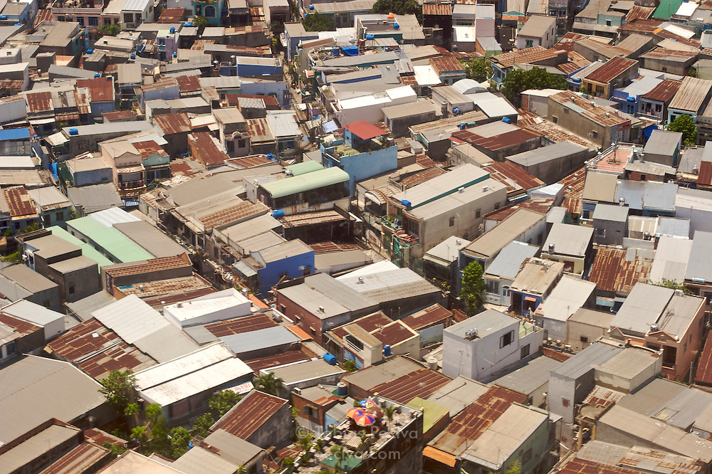 Aerial view of densely packed houses in a suburb of Ho Chi Minh City (Saigon), Vietnam.