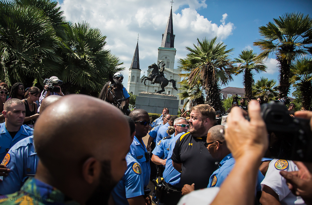 """A pro-monuemnt man in black and yellow shirt was arrested while interferring with the police during a protest in Jackson Square led by the """"TakeEmDownNola,"""" a group pushing for the city to remove Confederate monuments it voted to remove last year. The Andrew Jackson sculpture in Jackson square isn't one of them, but the group threatned to take it down. The police barricade the monument."""