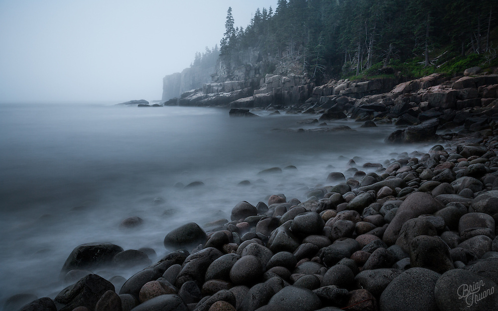 Near the Otter Cliffs in Acadia National Park, the large stones which break away from the cliffside are brought back ashore by the strength of the nor'easter storms which pass through the region. These boulders, mostly composed of granite, are tossed and turned over one another until they are rounded into smooth surfaces. Despite each stone being larger than a basketball, with each wave passing over causes the entire beach to clatter and quake.