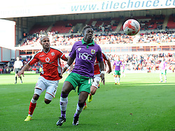 Bristol City's Kieran Agard battles for the ball with Walsall's Adam Chambers  - Photo mandatory by-line: Joe Meredith/JMP - Mobile: 07966 386802 - 04/10/2014 - SPORT - Football - Walsall - Bescot Stadium - Walsall v Bristol City - Sky Bet League One