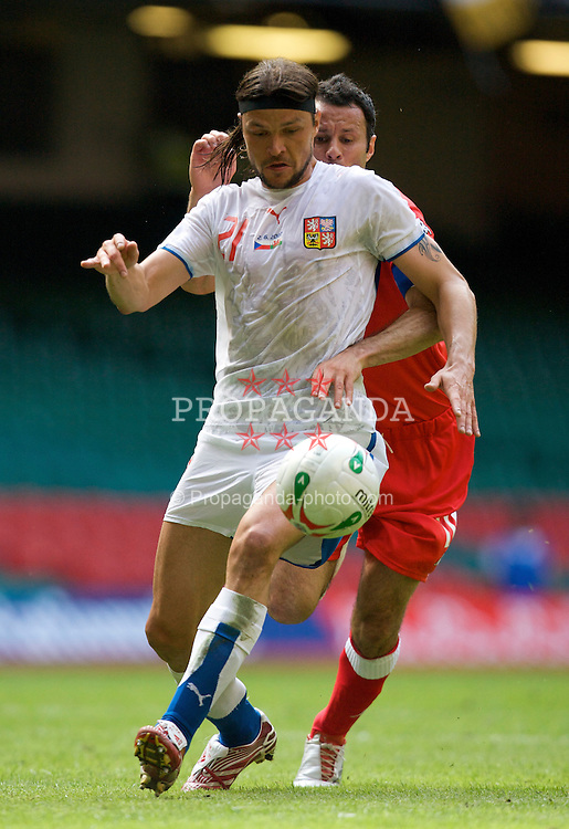 Cardiff, Wales - Saturday, June 2, 2007: Wales' captain Ryan Giggs and Czech Republic's Tomas Ujfalusi during the UEFA Euro 2008 Qualifying Group D match at the Millennium Stadium. (Pic by David Rawcliffe/Propaganda)