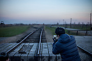 A visitors is taking a photograph at the Auschwitz Birkenau Nazi concentration camp. It is estimated that between 1.1 and 1.5 million Jews, Poles, Roma and others were killed in Auschwitz during the Holocaust in between 1940-1945.