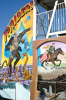 """Crude paintings decorate a """"Raiders"""" thrill ride at a traveling fair, Blue Hill, Maine."""